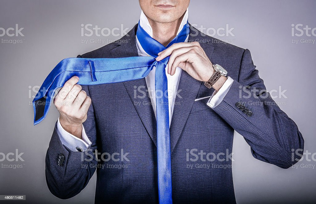 Manager in suit getting dressed stock photo