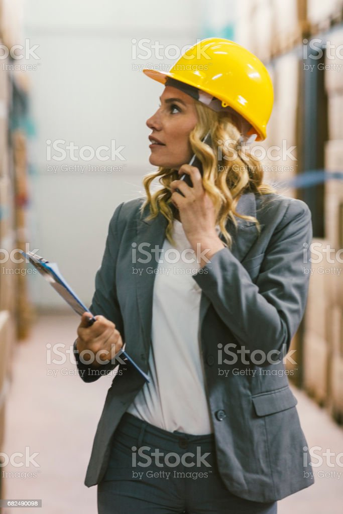 Manager in warehouse royalty-free stock photo