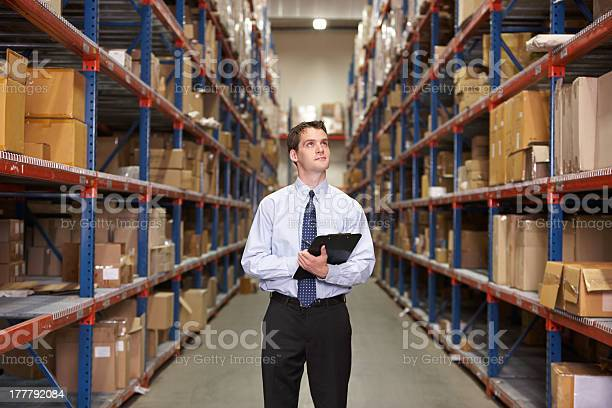Manager In Warehouse With Clipboard Stock Photo - Download Image Now
