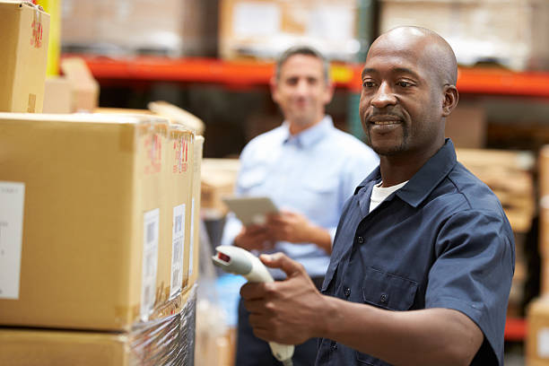 Warehouse worker pictures images and stock photos istock manager in warehouse with worker scanning box stock photo sciox Choice Image