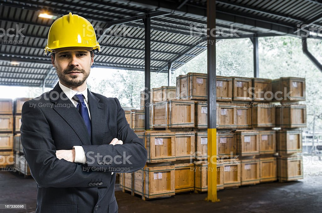 Manager, Inspector, Owner in external industrial warehouse with wooden boxes royalty-free stock photo
