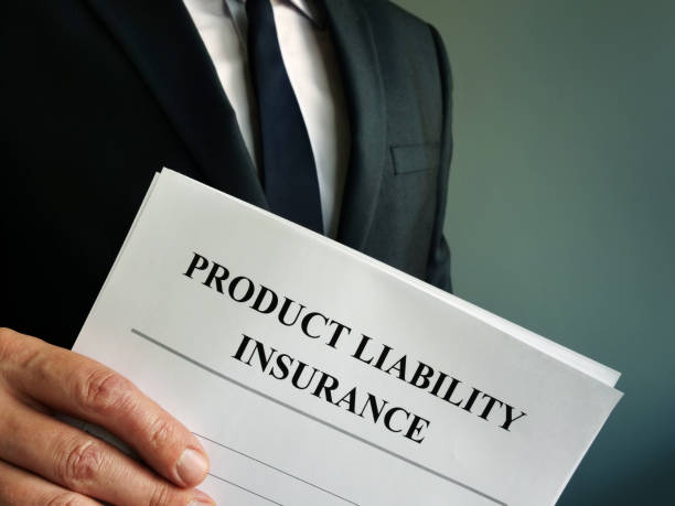 manager is holding product liability insurance policy. - sorte foto e immagini stock