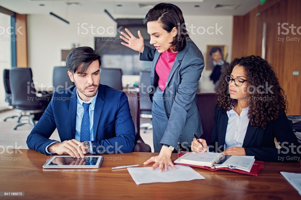 Manager is shouting to employee after his mistake in the CEO office stock photo