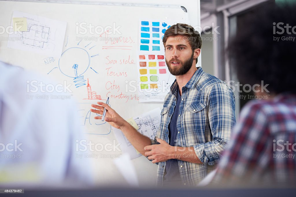 Manager Leading Creative Brainstorming Meeting In Office stock photo