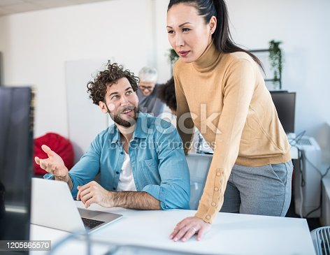 1147760705 istock photo A manager listening to the ideas of a creative employee with expertise. They are coming up with a new product. 1205665570