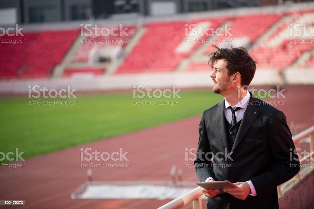 Manager man on stadium stock photo