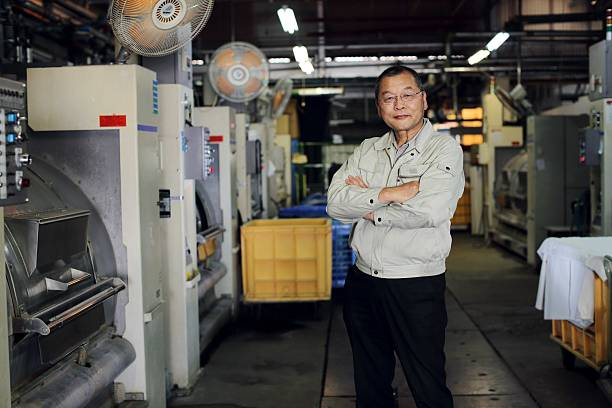 Manager of a factory full of confidence ストックフォト