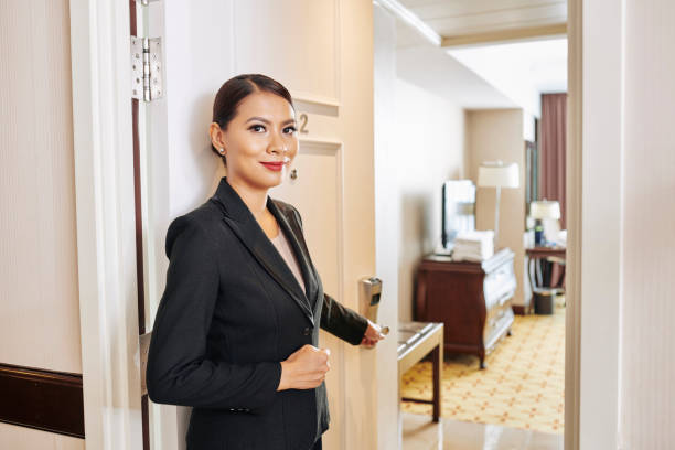 Manager of the hotel showing the room stock photo