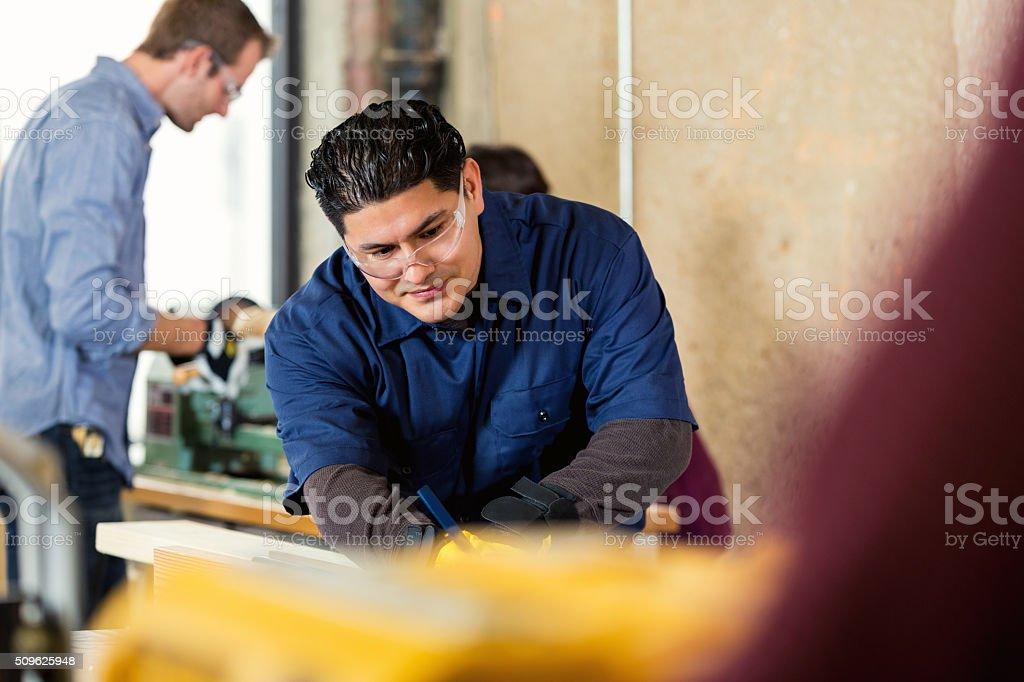 Manager of workshop works on customer order stock photo