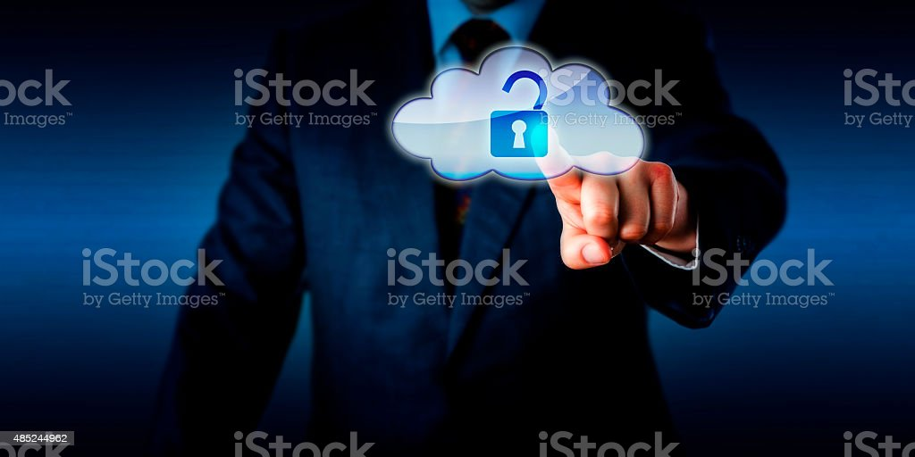 Manager Opening A Lock In The Cloud Via Touch stock photo