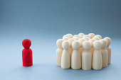 istock A Manager or Leader addressing a group of people or being isolated because of diversity 1211628101