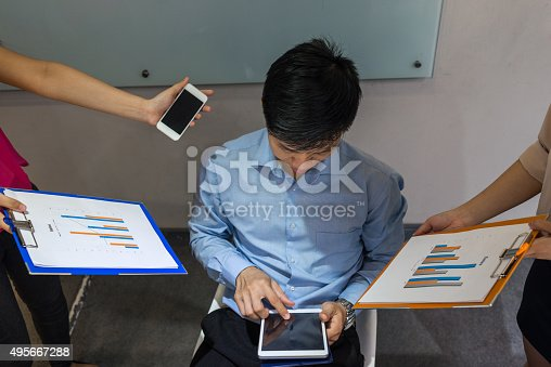 istock Manager playing tablet although he has many works to handle 495667288