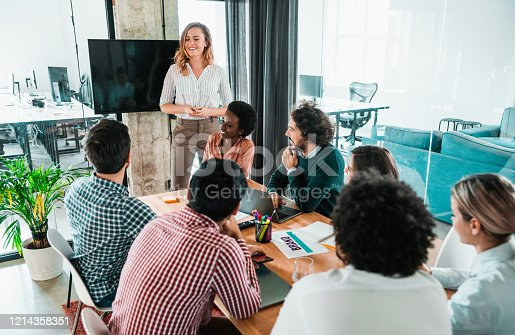 842214506 istock photo Manager presenting her coworkers new business strategy on a meeting. 1214358351