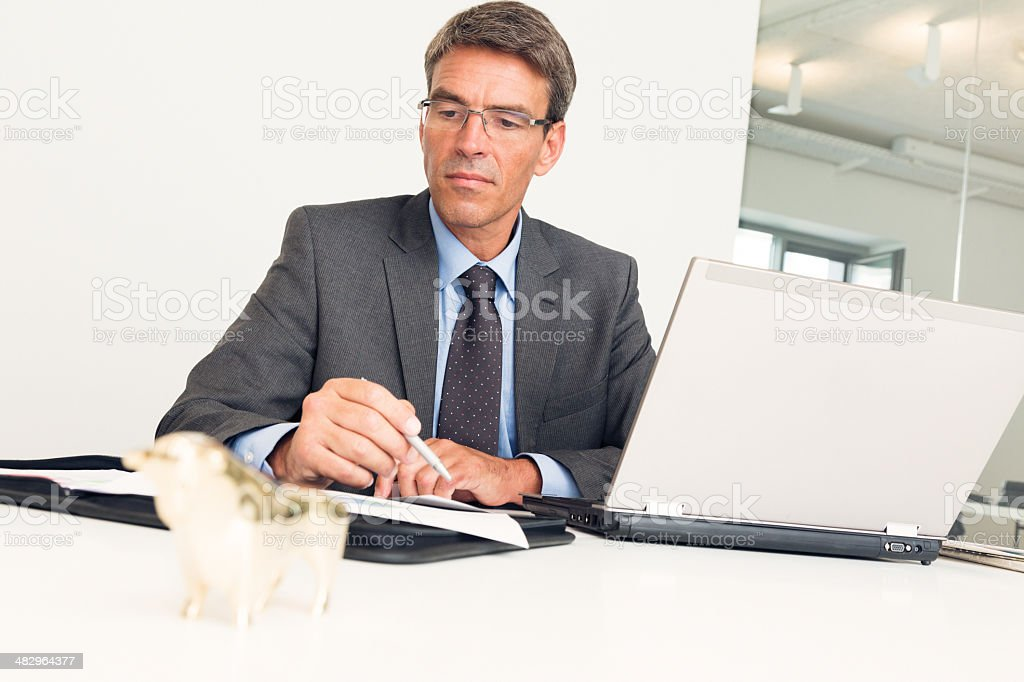 manager sitting at his desk royalty-free stock photo