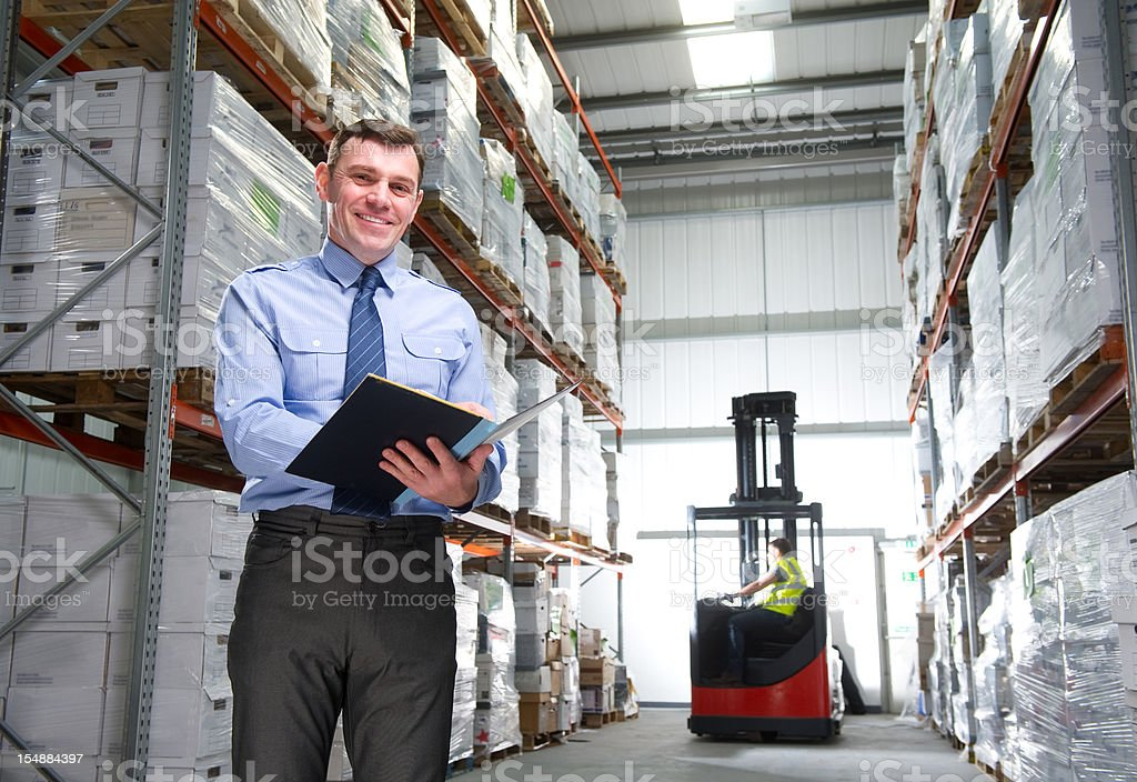 Manager Smiling in a Warehouse royalty-free stock photo