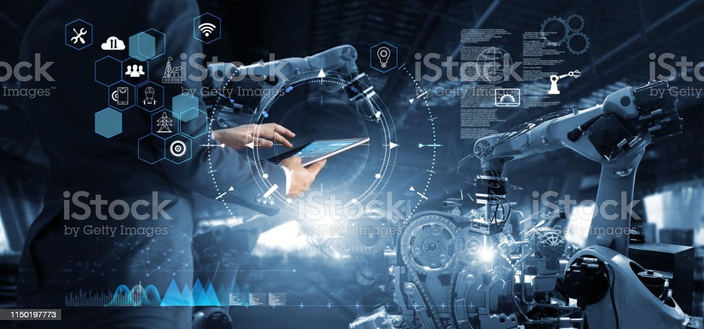 Manager Technical Industrial Engineer working and control robotics with monitoring system software and icon industry network connection on tablet. AI, Artificial Intelligence, Automation robot arm Manager Technical Industrial Engineer working and control robotics with monitoring system software and icon industry network connection on tablet. AI, Artificial Intelligence, Automation robot arm Abstract Stock Photo