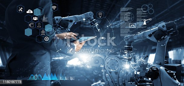 istock Manager Technical Industrial Engineer working and control robotics with monitoring system software and icon industry network connection on tablet. AI, Artificial Intelligence, Automation robot arm 1150197773