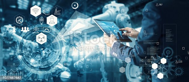 istock Manager Technician Industrial Engineer working and control robotics with monitoring system software and icon industry network connection on tablet. AI, Artificial Intelligence, Automation robot arm machine in smart factory on blue digital background, Inno 1022887882