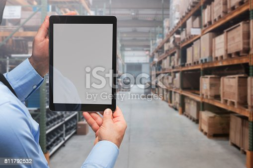 istock Manager using digital tablet in warehouse 811792532