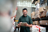 istock Manager using his tablet working in warehouse / industry 1195904351