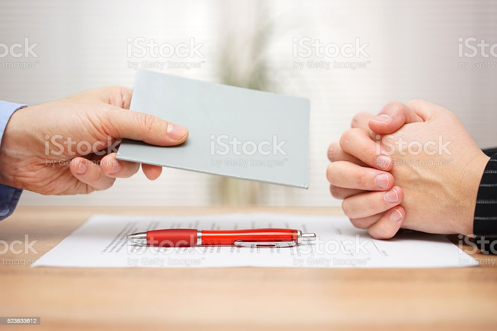 manager want to fired employee and he is showing Employee stock photo