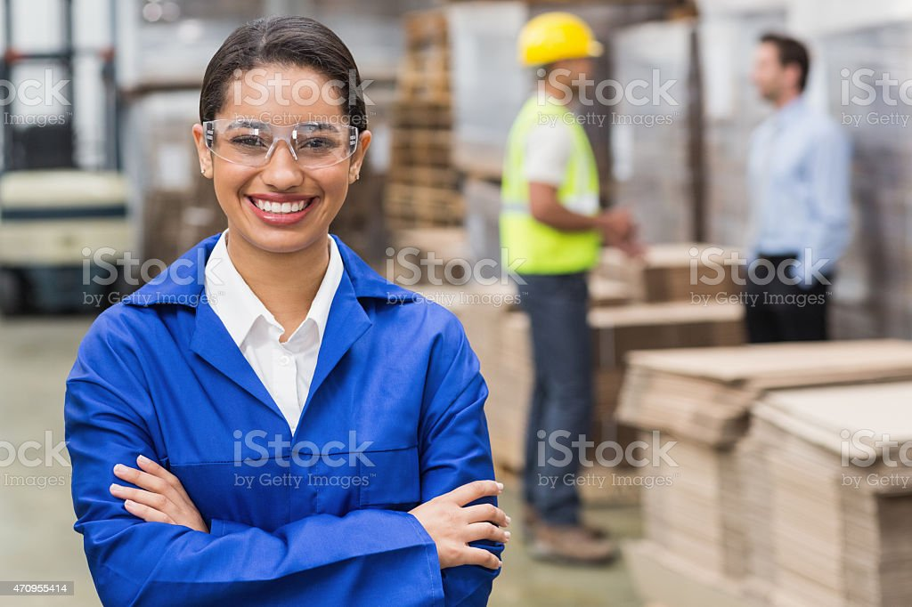 Manager wearing protective mask looking at camera stock photo