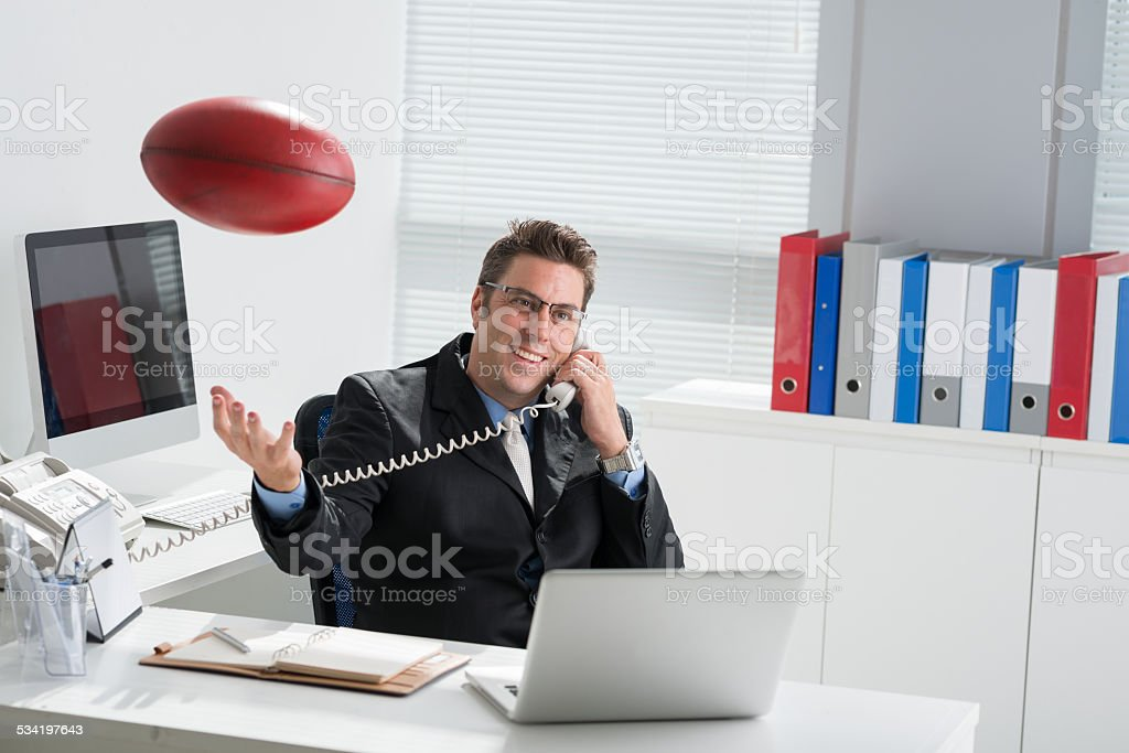 Manager with a rugby ball stock photo