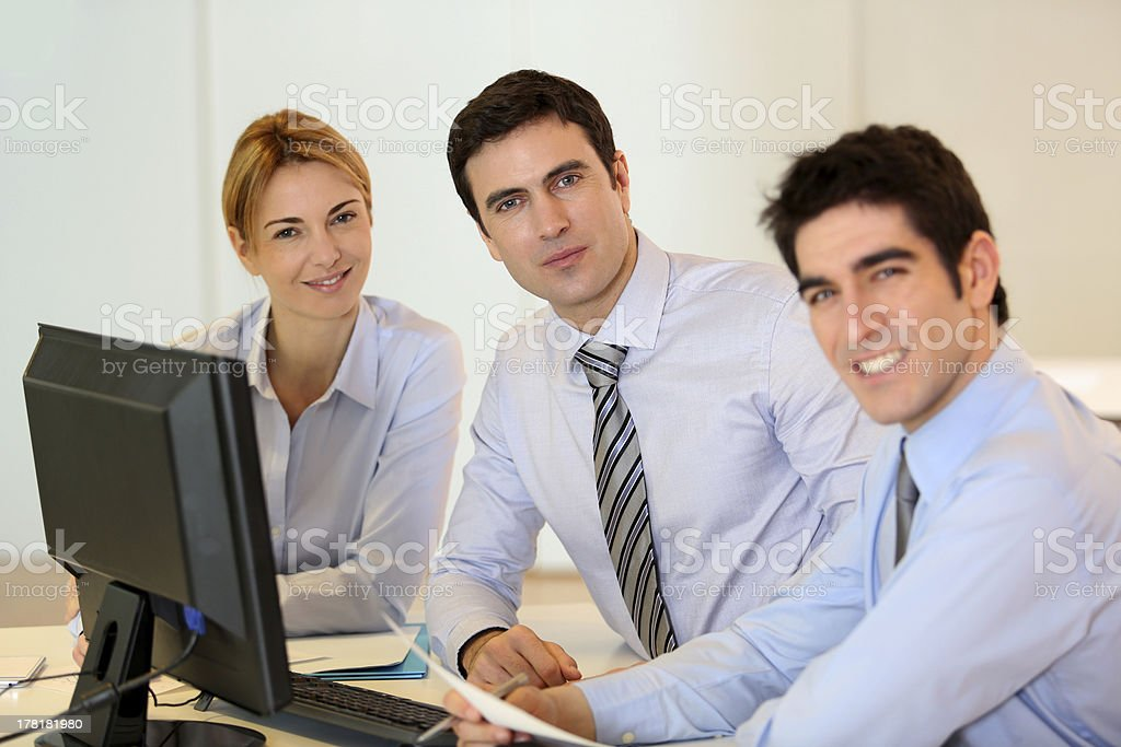 Manager with his team around computer royalty-free stock photo