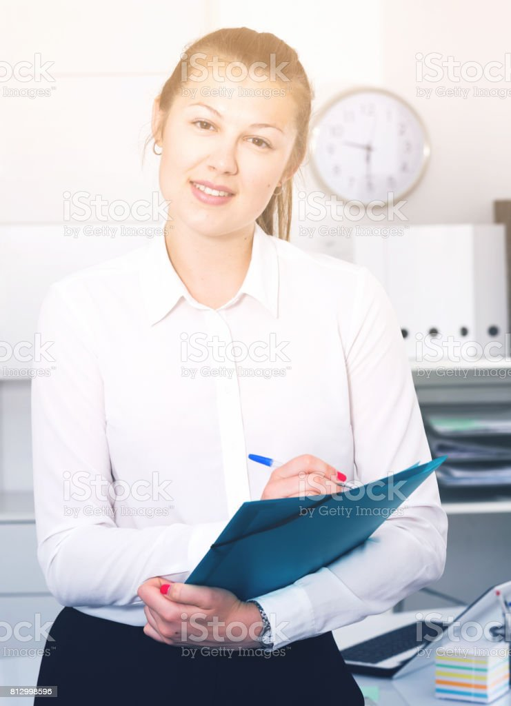manager woman is signing agreement papers of financial nature stock