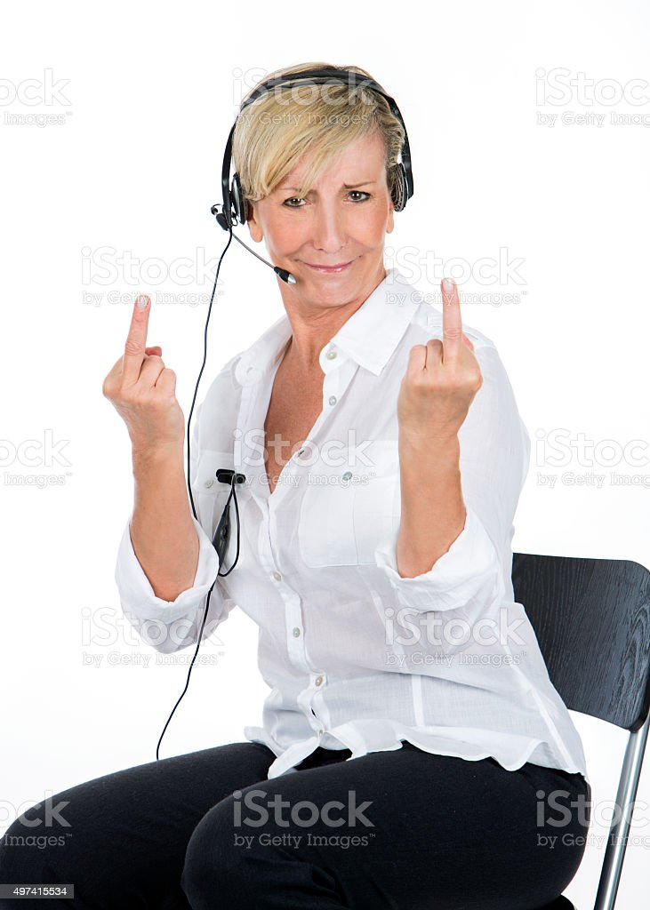manager woman with the headsets doing midle finger stock photo