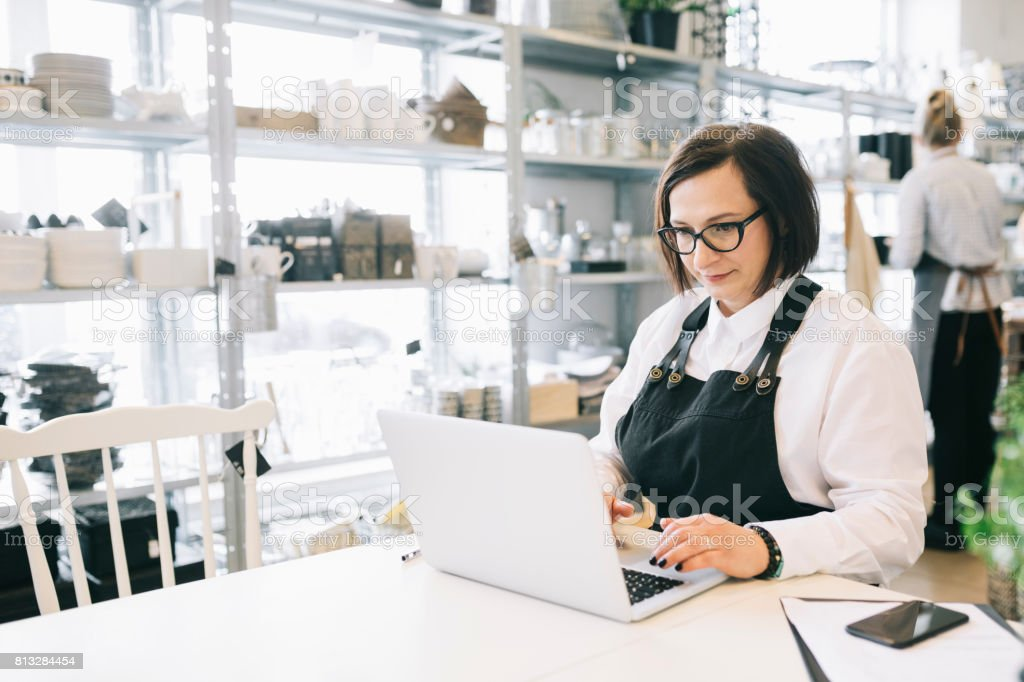 Manager working in a Small Design Shop stock photo