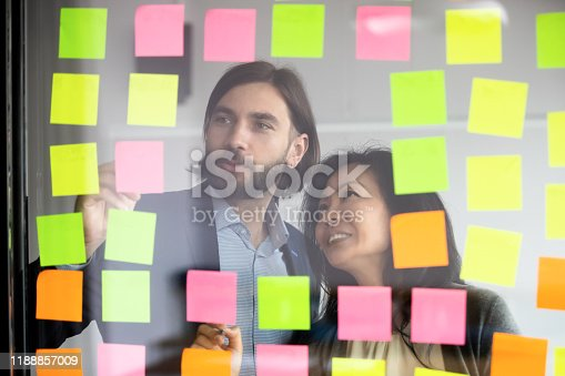 1144569896 istock photo Manager working with middle aged korean supervisor near glass wall. 1188857009