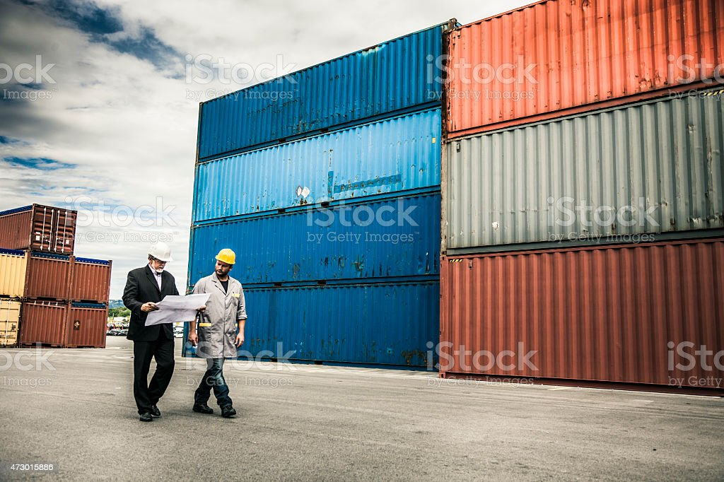 Managers and worker at commercial dock stock photo