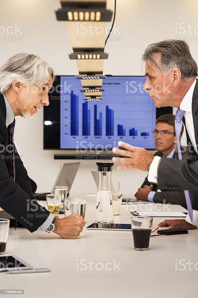 managers arguing royalty-free stock photo