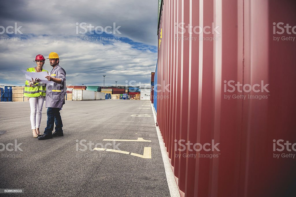 Managers at commercial dock stock photo