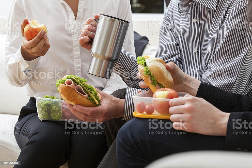 Managers eating meal together stock photo