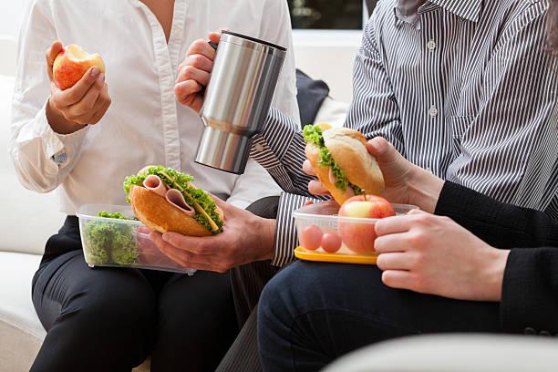 managers eating meal together - lunchrast bildbanksfoton och bilder