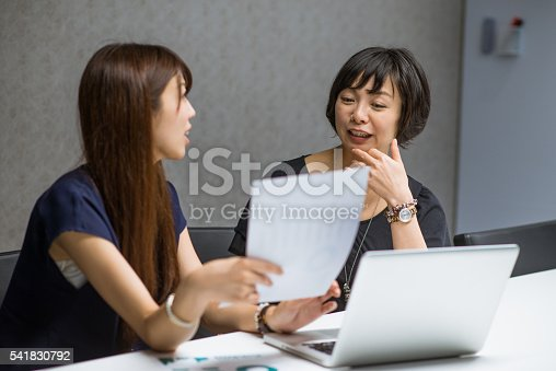 589445574istockphoto Managers in office facing market challenges. 541830792