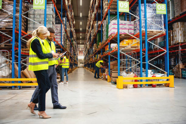 Managers in Warehouse discuss about business stock photo