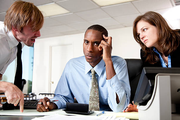 Managers scolding an employee stock photo