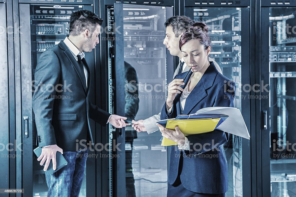 Managers talking in the server room royalty-free stock photo