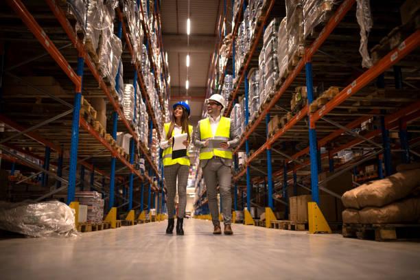 Managers walking through large warehouse controlling goods picture id1147988386?b=1&k=6&m=1147988386&s=612x612&w=0&h=iahispoirieoqm jg8 kvvs3 n1e2u1v kdwwsyvgym=
