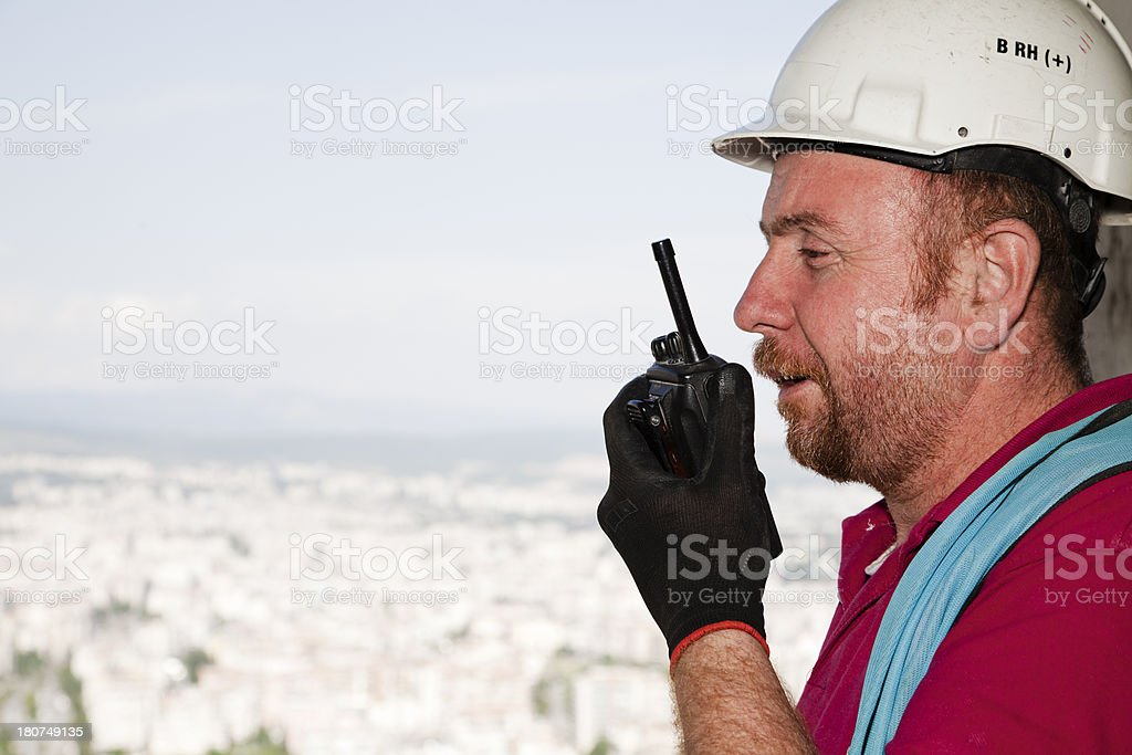 Manager-worker talking on the radio royalty-free stock photo