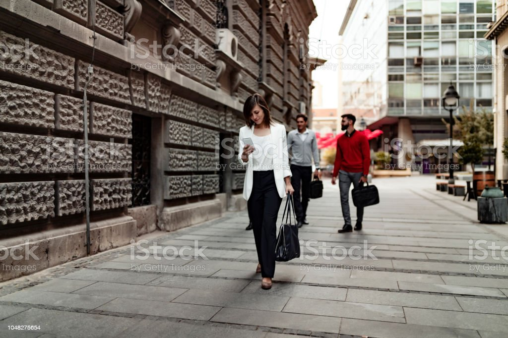 Managing her work day the digital way stock photo