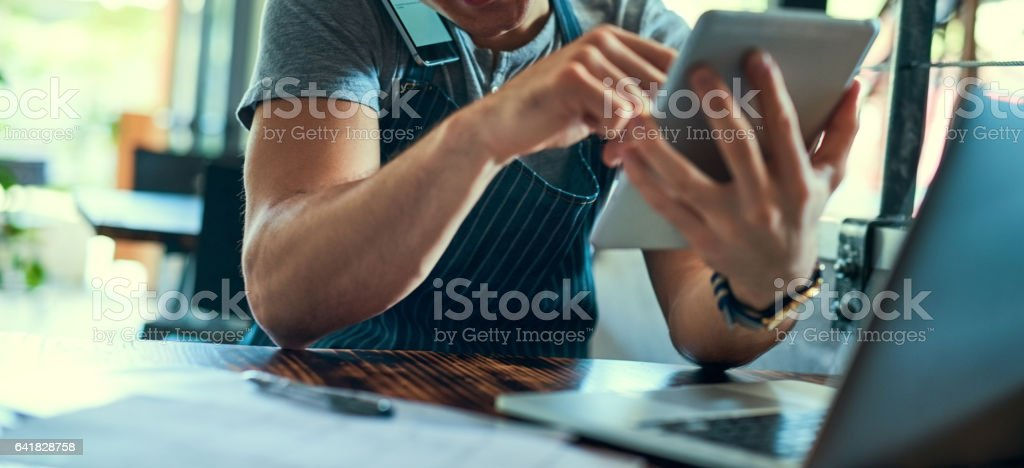 Managing his coffee shop the smart way stock photo
