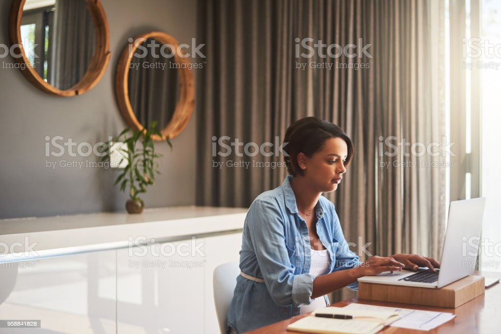 Managing pregnancy and her monthly bills stock photo