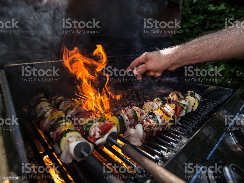 managing the BBQ stock photo