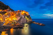Photo of colorful fishing houses the fishing port of Manarola at dawn, Cinque Terre World Heritage National Park, Ligurian Riviera, Italy