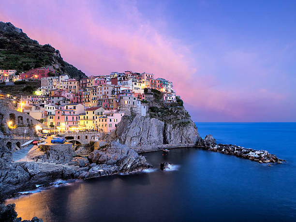 manarola view at sunset - international landmark stock photos and pictures
