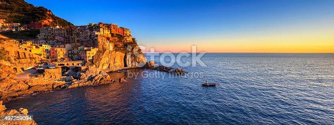 istock Manarola village panorama, rocks and sea at sunset. Cinque Terre 497259094